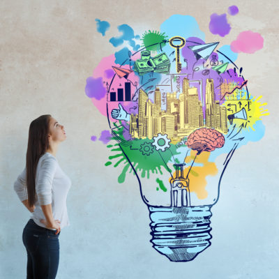 Side view of thoughtful european woman on concrete background with colorful business sketch. Creativity concept