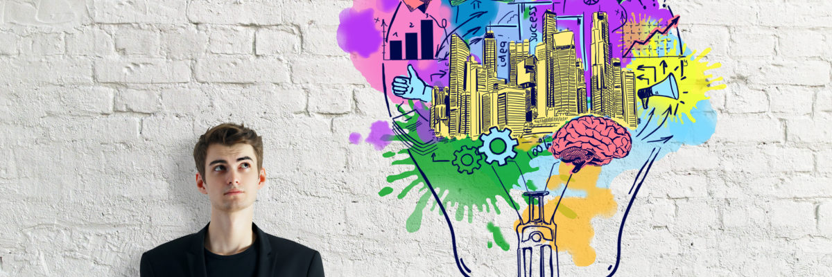 Thoughtful young businessman with coffee cup on brick background with colorful lamp sketch. Creative business concept